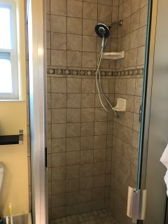 Large unit-Large Glass in Shower completely tiled