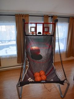 Indoor basketball game at the home.