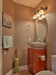 This convenient half bathroom is located just off of the kitchen.