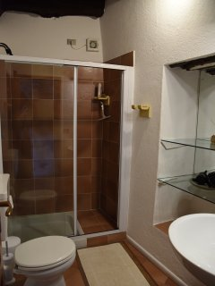 Ground floor bathroom with shower, situated next to small lounge & utility room.
