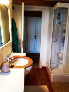 En-suite sauna/shower bathroom to 2rd flr master bedroom, bidet and view of lake