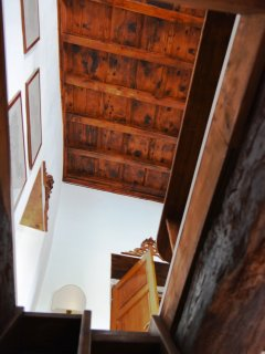 Internal wooden mountain style stairs leading up to 1st floor large lounge.