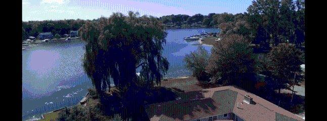 Spring Lake view to Lake Michigan with dock, kayaks, fire pit, hot tub, basket ball hoop game room..
