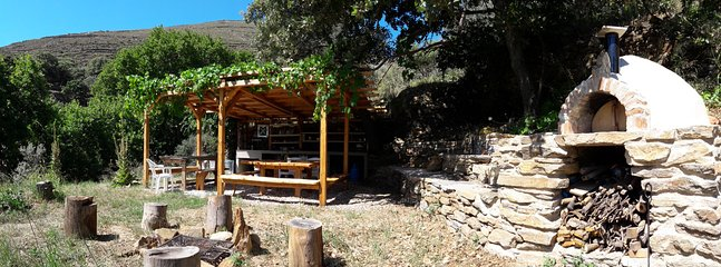 the outdoor kitchen, bbq area and pizza oven at the vegetable garden