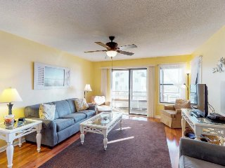 Bright condo with shared pool, hot tub & water views - walk to the beach!