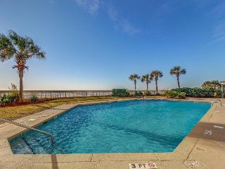 Gorgeous ocean views and shared pool await from this beachfront condo!