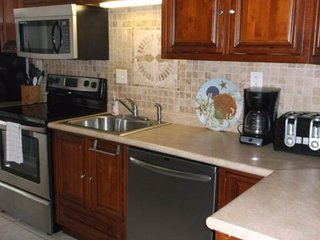 Waterfront and dog-friendly studio with shared pools, grilling, and picnic areas