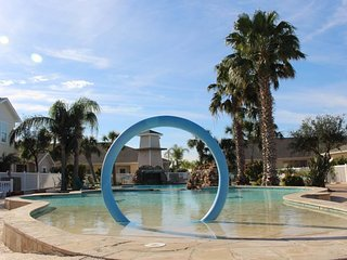 Dog-friendly condo with a shared pool and easy beach access!