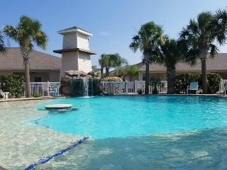Townhome by the water features access to heated pool, grill, and more!
