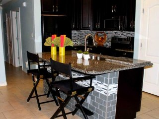 Bright and colorful condo w/ shared pool - walk to dining, near Whitecap Beach!