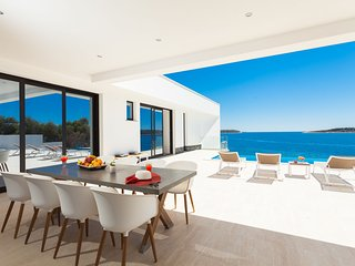 Beachfront Villa Blue Heaven with Pool