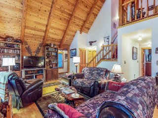 Dog-friendly log home w/ deck & shared pools, hot tubs, tennis, gym, dock & more