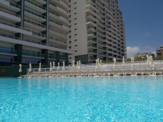 The complex large residential pool with sunbeds and umbrellas - free access