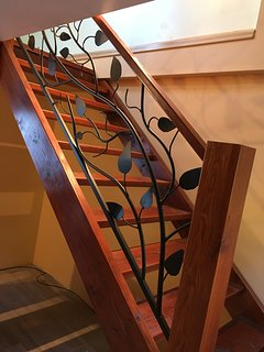 Handcrafted fir staircase up to loft