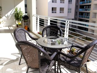 Very sunny 35 m² front corner terrace with comfortable outdoor furniture