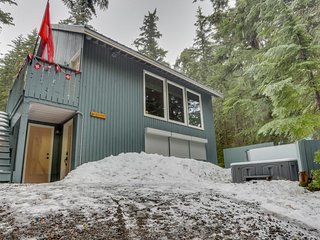 Swiss-themed getaway with private hot tub, wood stove & backyard trail access!