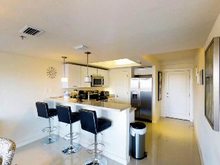 Modern, chic condo w/ bay views, shared pools & hot tubs - small dogs welcome!