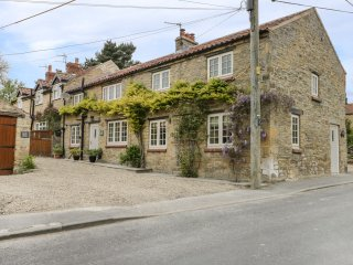 TILLERS COTTAGE, four bedroom, en-suite, wood-burning stove, open beams, near
