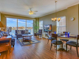 Entertain or relax and enjoy the view after a Great Beach Day in this Spacious Living Area with a Flat Screen TV, Comfy New Couch and Sleeper Sofa