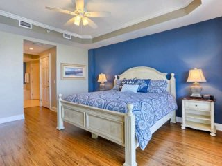 Unwind after great day with the family in this spacious Master Bedroom with King Bed, Flat Screen TV, and Large  Private Master Bathroom