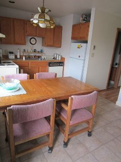 All the amenities of home in this eat-in kitchen.