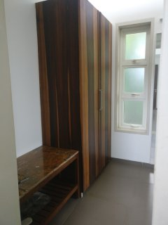 Walk in wardrobe area with Luggage Rack