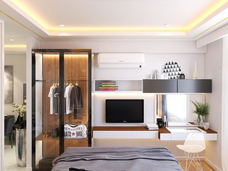 a luxury bedroom with all facibilitys