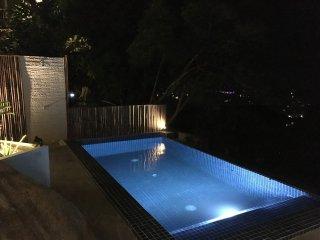 Stunning pool area at night.