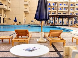 Poolside Studio with Free WIFI and Outside Patio