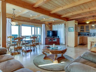 Enjoy decks, ocean views, private hot tub  & shared pool/sauna by golf & trails!