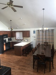 Great room with cathedral ceilings - kitchen, dining, and living room.