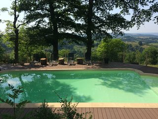 Les Hauts Pâturages sleeps up to 15 with outdoor heated pool and fabulous views