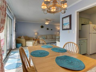 Condo features freshwater views, shared pool, and easy access to the beach!
