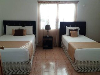 Rooms in Cancun Residential zone.