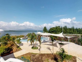 Two private waterfront retreats w/ pool access, close to gorgeous beach