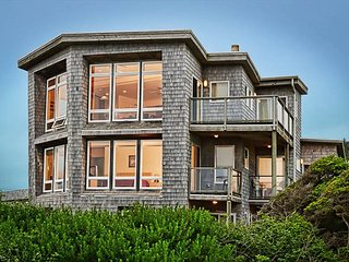 Oceanfront home with elevator, fireplace and private balconies!
