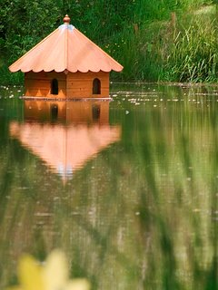 The lake and duck house at Newhouse Farm Cottages
