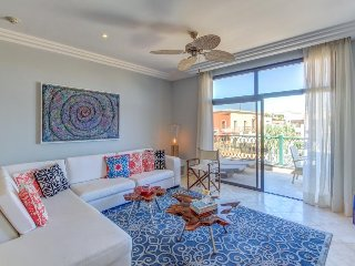Modern condo in waterfront building with shared pool, close to the beach & golf