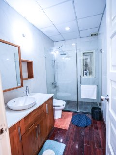 Neat and tidy bath and shower room with all amenities.