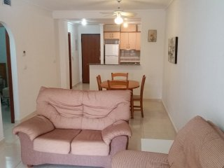 Open plan lounge kitchen/diner with aircon.