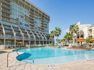 Dog-friendly condo w/ bay view, shared pools & hot tubs - walk to beach!