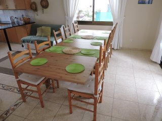 Spacious Dining Table - extended to seat ten  people. Double futon