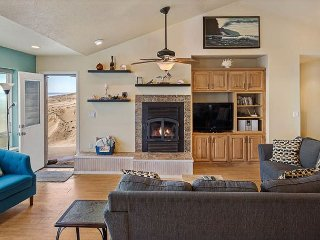 Explore the beach and then cozy up next to the fire in this OCEAN FRONT home!