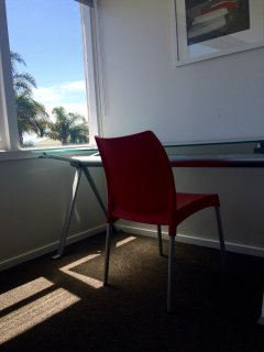 Stylish desk and chair with a stunning view, it might be hard to get any work done!