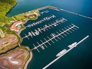 Exclusive Marina condos, surrounded by luxury yachts