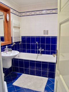 Bathroom with separate bath and shower corner.
