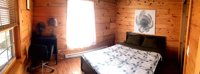 One of two main floor master bedrooms with queen beds