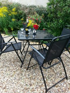 Relax and enjoy with a glass of wine in the rear garden