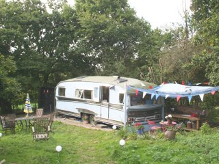 STAR GLAMPING  in The Star, a Vintage 1970s Showman's Wagon. Glamorous and fun.
