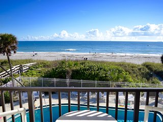 Beautiful views from your bed and balcony, on the beach and steps to the pier!